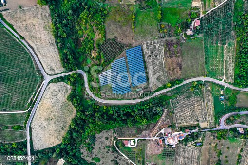 1170098138istockphoto Solar panels fields on the green hills 1028452404