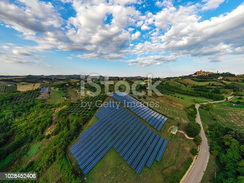 1170098138istockphoto Solar panels fields on the green hills 1028452406
