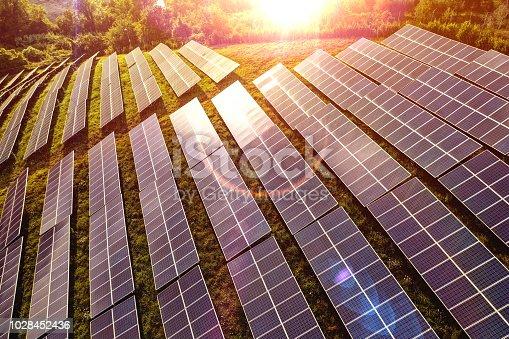 1170098138istockphoto Solar panels fields on the green hills 1028452436