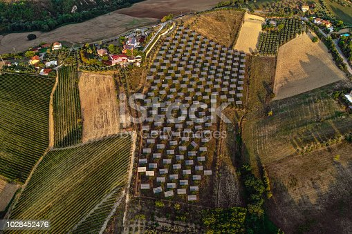 1170098138istockphoto Solar panels fields on the green hills 1028452476