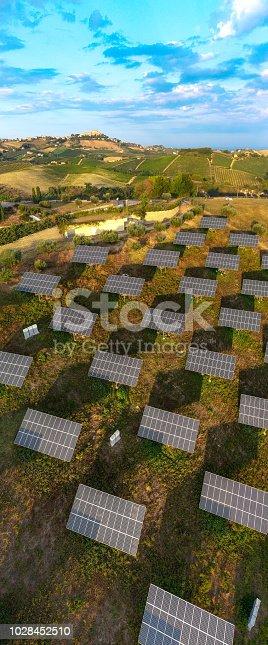 1170098138istockphoto Solar panels fields on the green hills 1028452510