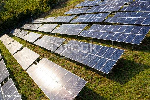 1170098138istockphoto Solar panels fields on the green hills 1170097008