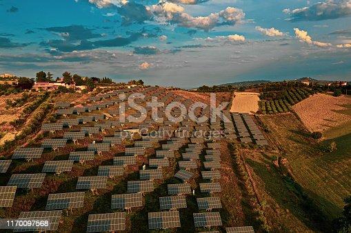 1170098138istockphoto Solar panels fields on the green hills 1170097568