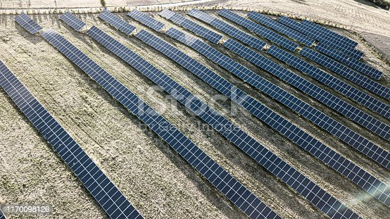 1170098138istockphoto Solar panels fields on the green hills 1170098126
