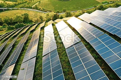 istock Solar panels fields on the green hills 1170098138