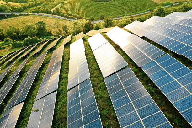 Solar panels fields on the green hills Solar panels fields on the green hills drone point of view stock pictures, royalty-free photos & images
