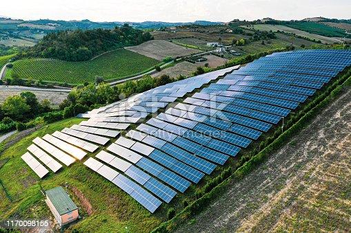 1170098138istockphoto Solar panels fields on the green hills 1170098155