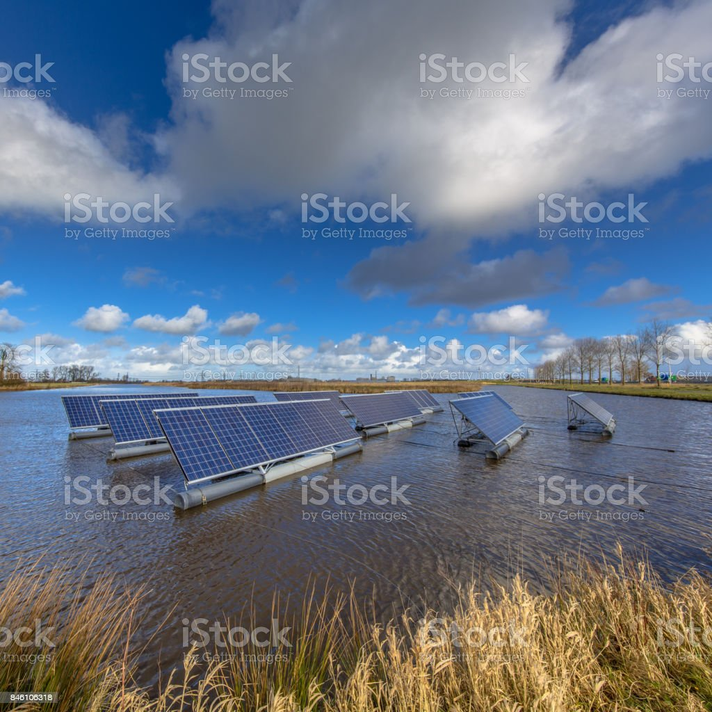 Solar panels floating on water stock photo