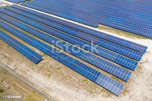 Aerial view of solar panels in large field, taken by quadcopter. Clean energy for a better future.