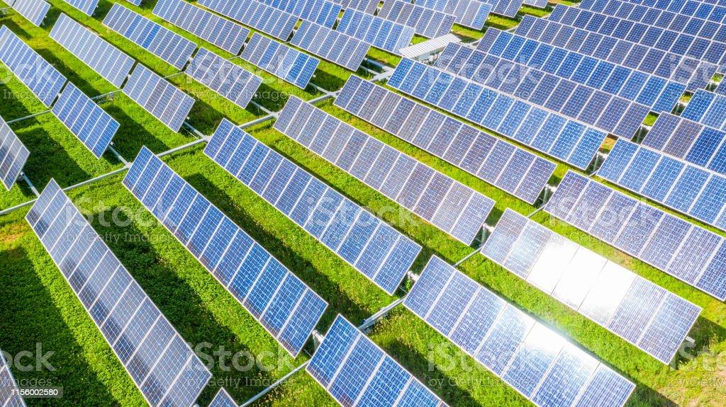 Solar panels in aerial view, Renewable energy with photovoltaic panels. Solar panels in aerial view, Renewable energy with photovoltaic panels. Above Stock Photo
