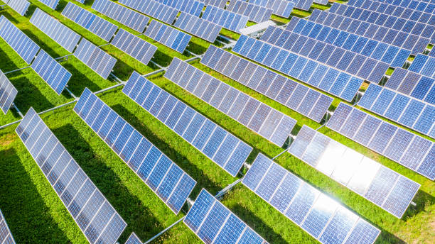 Solar panels in aerial view, Renewable energy with photovoltaic panels. stock photo