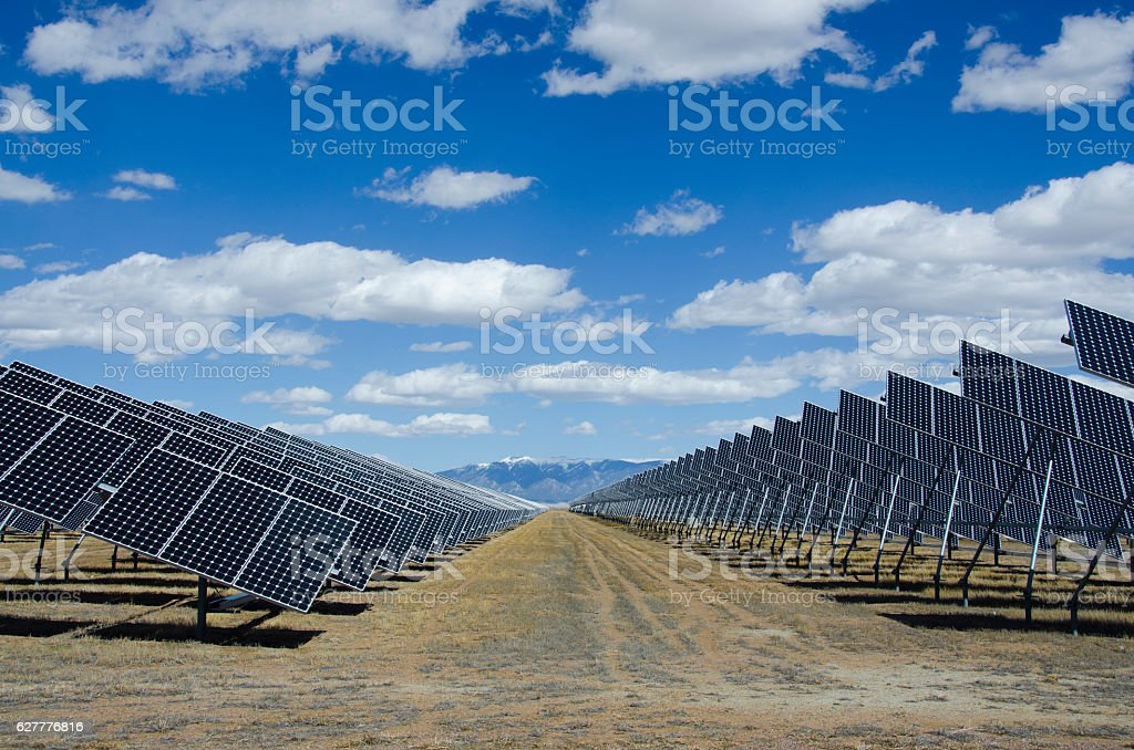 Solar Panels in Power Plant with Sangre de Cristo Mountain stock photo