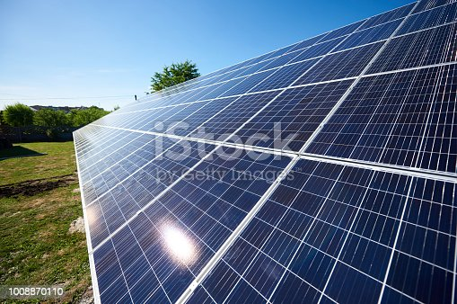 istock Solar panels installed on outdoors opened space sideview. 1008870110