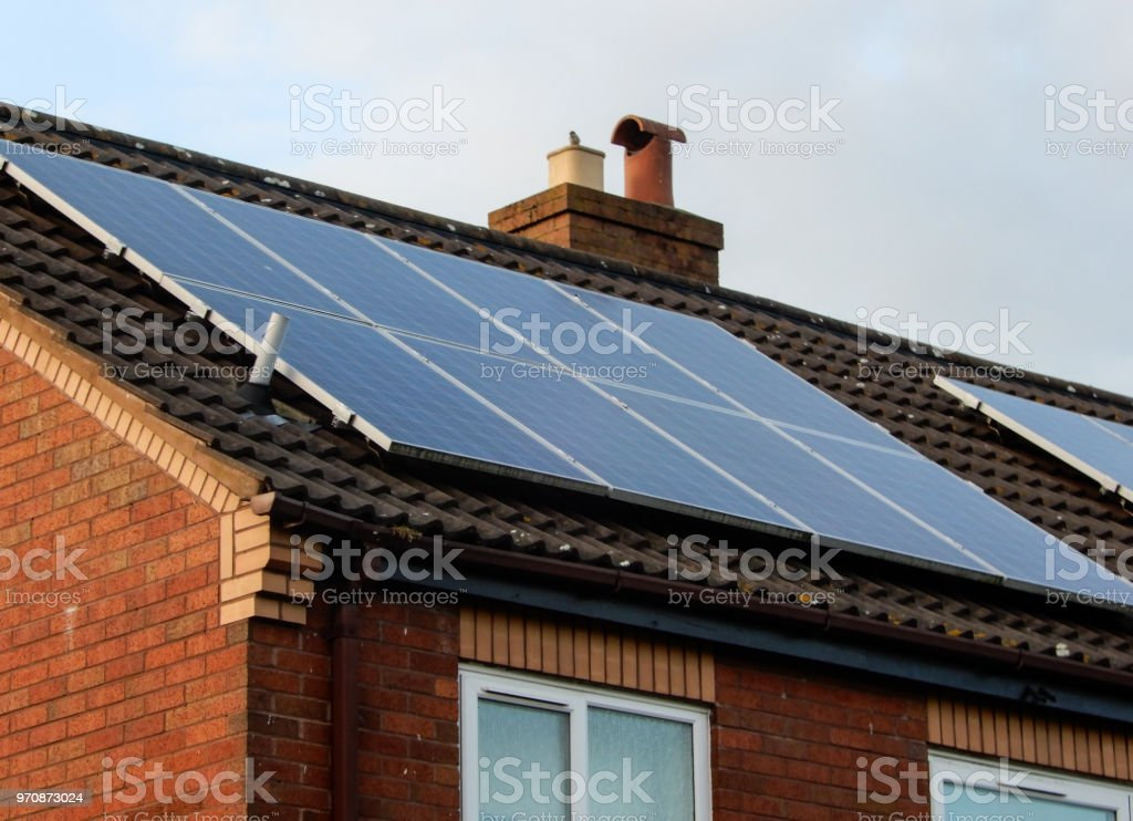 Solar panels mounted on a house roof in Reading. stock photo