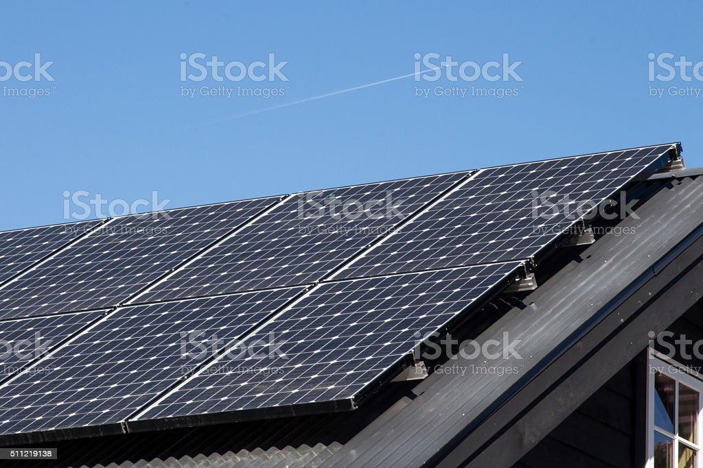 Solar panels on a home rooftop stock photo