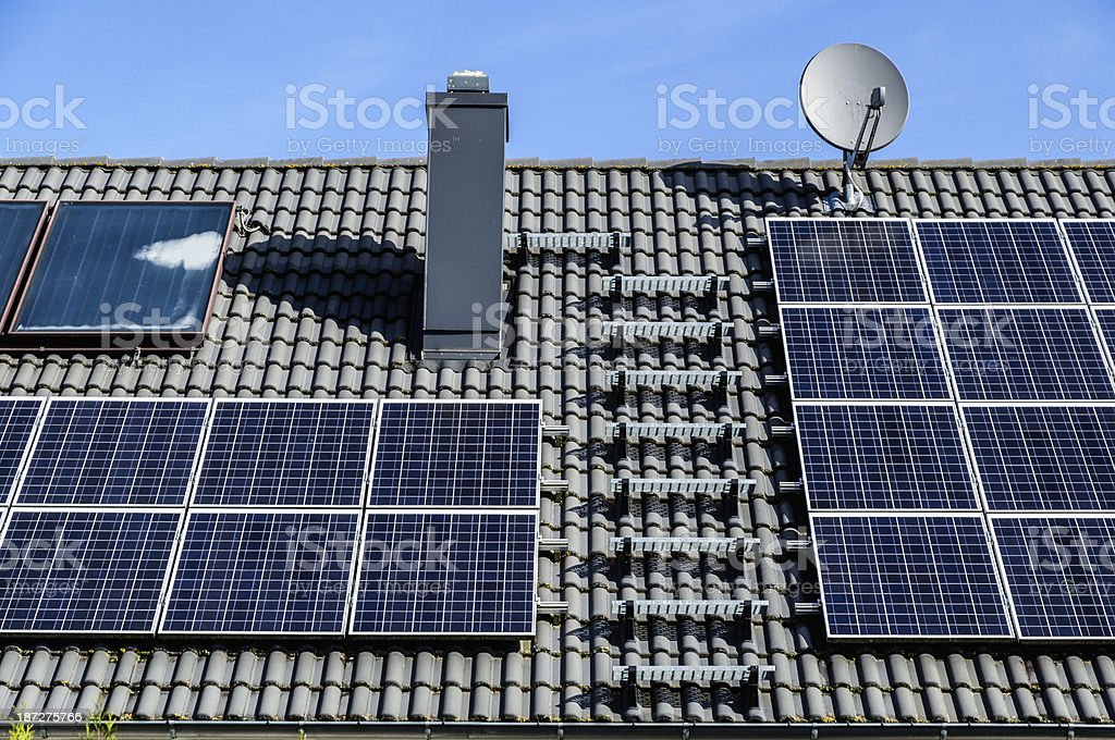 Solar panels on a house roof stock photo