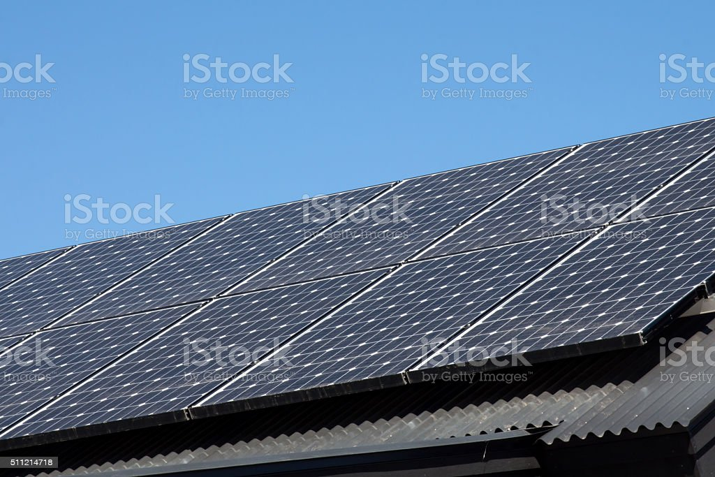 Solar panels on a metal pitched roof stock photo