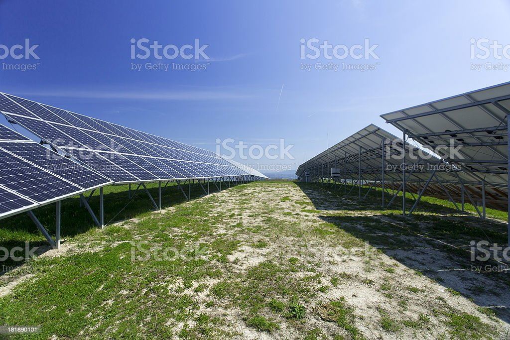 Solar panels on a sunny day against clear blue sky royalty-free stock photo
