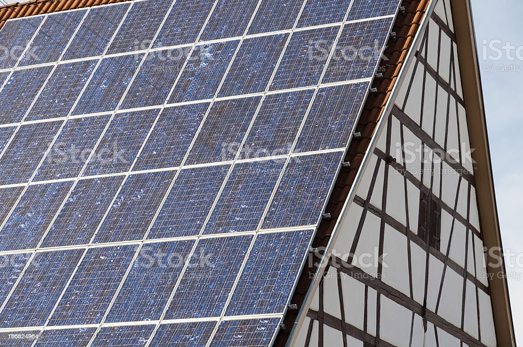 Solar panels on a timber-framed house stock photo