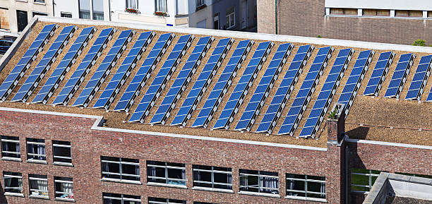 Solar panels on building roof stock photo