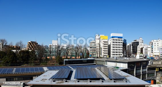istock Solar panels on building rooftop 1303938048