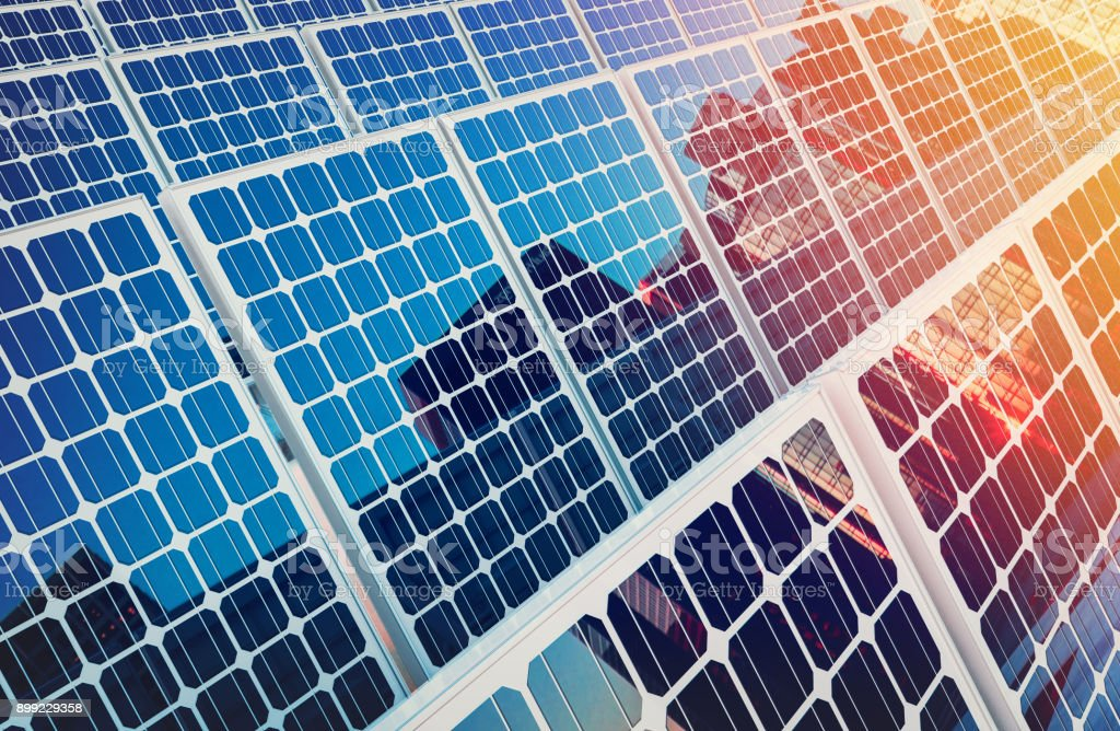 Solar panels on buildings reflect the city. royalty-free stock photo