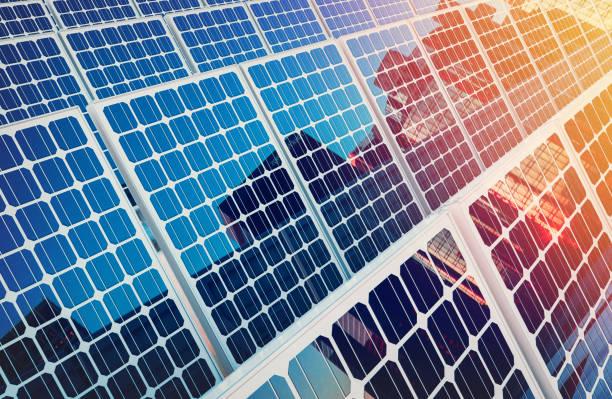 solar panels on buildings reflect the city. - pannelli solari foto e immagini stock