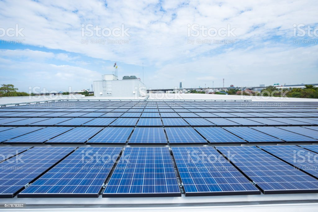 Solar panels on factory roof stock photo