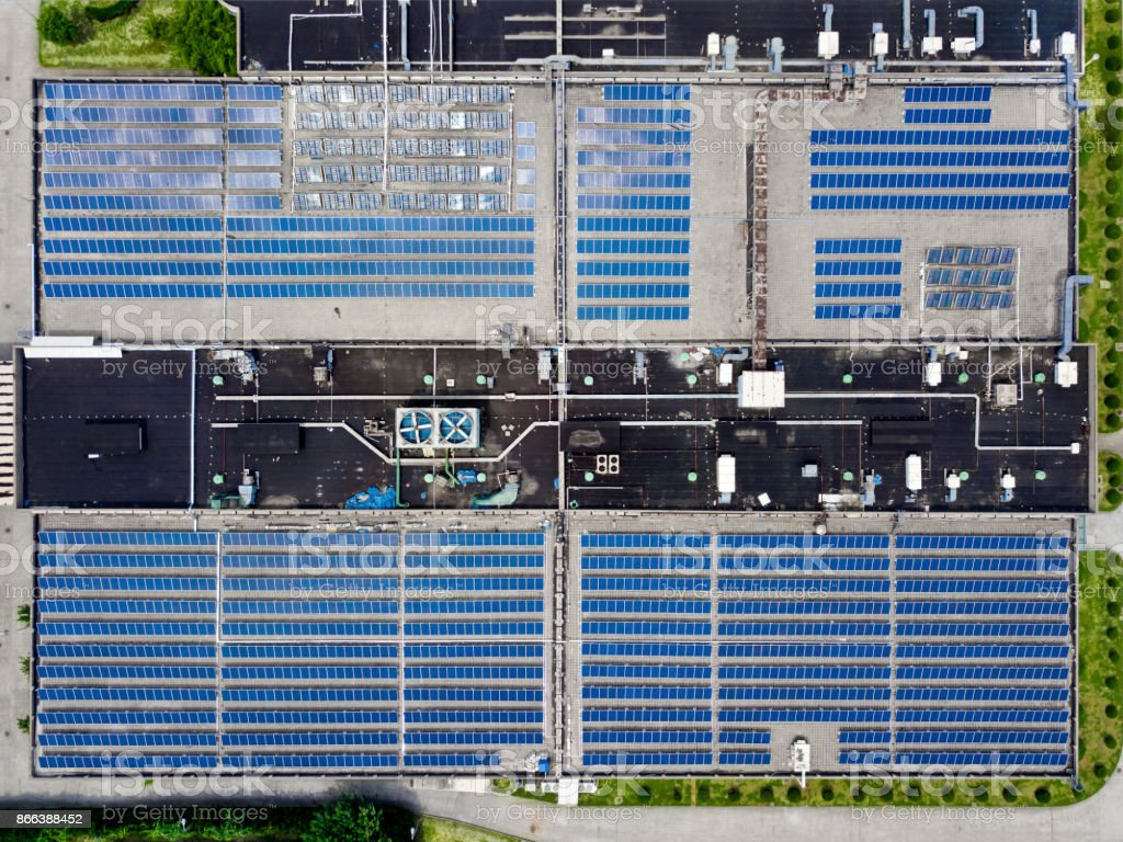 Solar panels on factory rooftop stock photo
