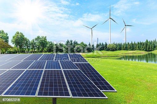 istock Solar panels on green grass 670652018