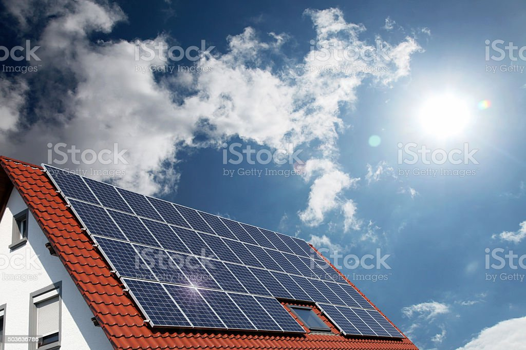 Solar panels on house roof Solar panels on house roof Environmental Conservation Stock Photo