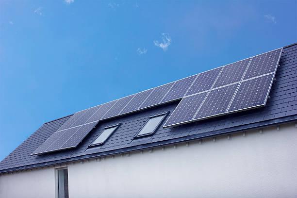 Solar Panels On House Roof. Sustainable Renewable Energy stock photo