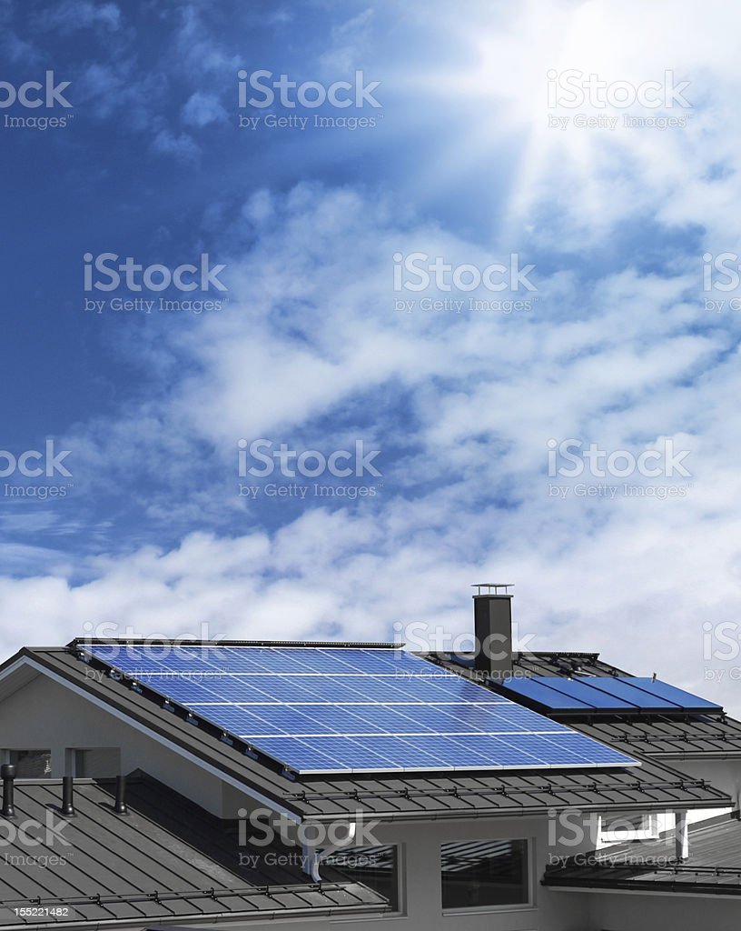 Solar panels on house rooftop stock photo
