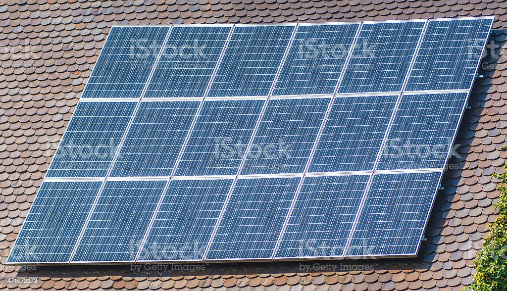 solar panels on real estate home stock photo