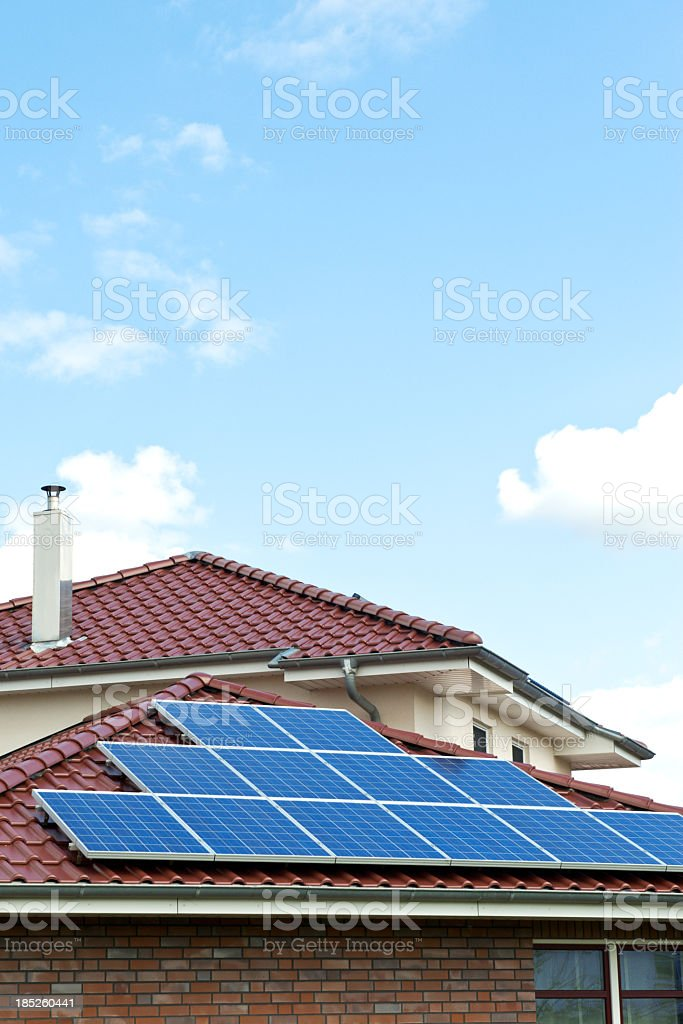 Solar panels on red roof a nice day stock photo
