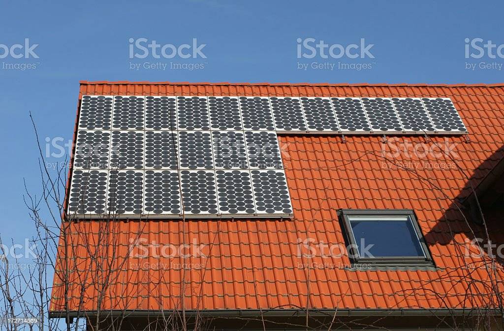 solar panels on roof - green energy royalty-free stock photo