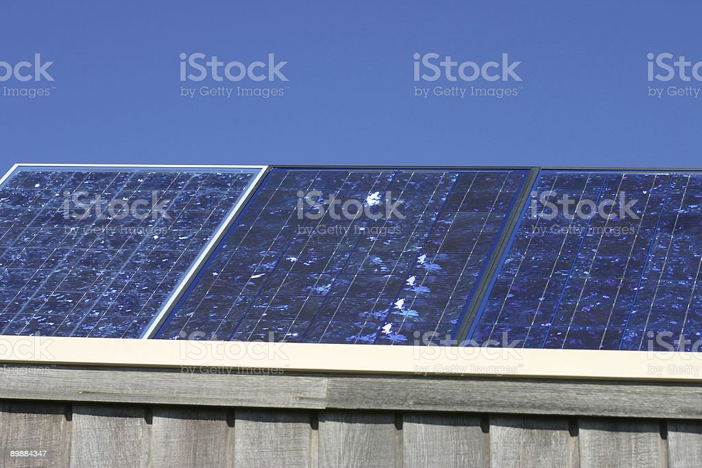 Solar panels on roof of a batch royalty-free stock photo