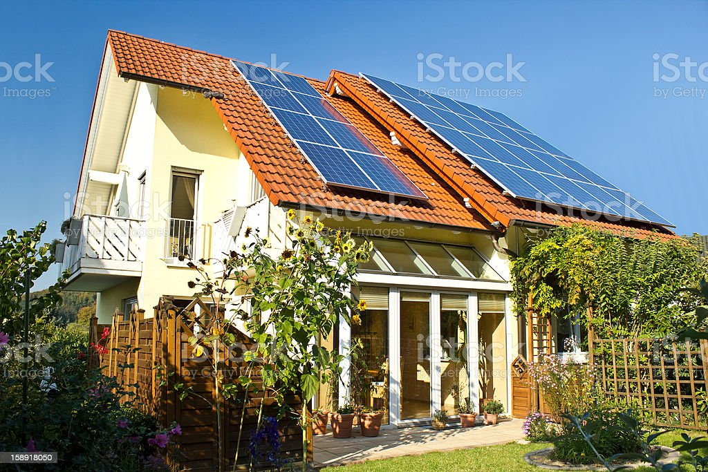 Solar panels on roof of house in late summer stock photo