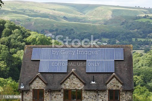 Shropshire, UK - September 10, 2013. Solar panels fitted to the roof of a house in rural England. In the summer of 2016 solar energy provided around 5% of the UK's electricity