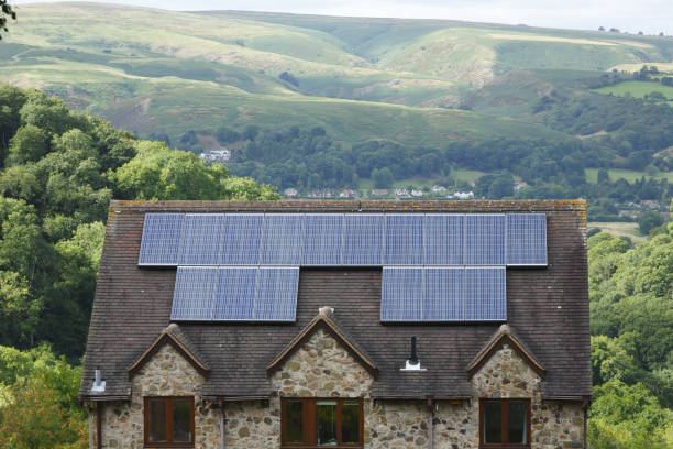 Solar panels on roof of house UK stock photo
