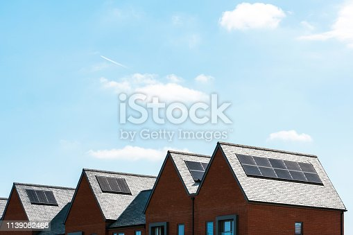904490858istockphoto solar panels on roof of new houses in england uk on bright sunny day 1139082468