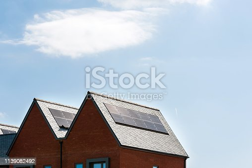 904490858istockphoto solar panels on roof of new houses in england uk on bright sunny day 1139082492