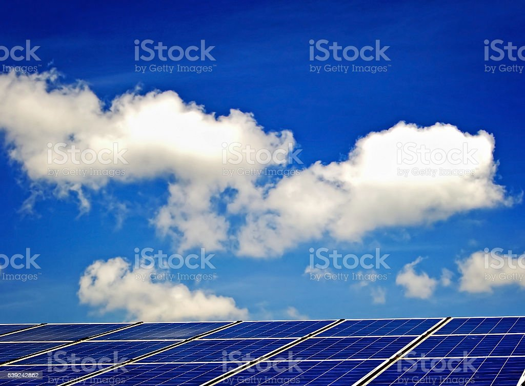 Solar panels on sky and clouds background royalty-free stock photo