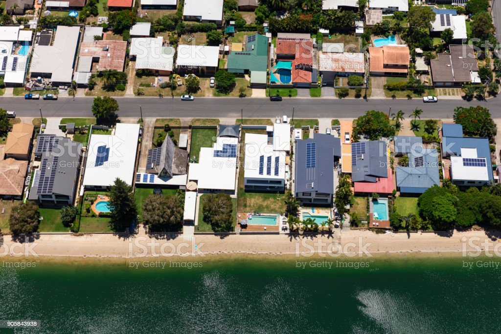 Solar panels on suburban waterfront homes stock photo