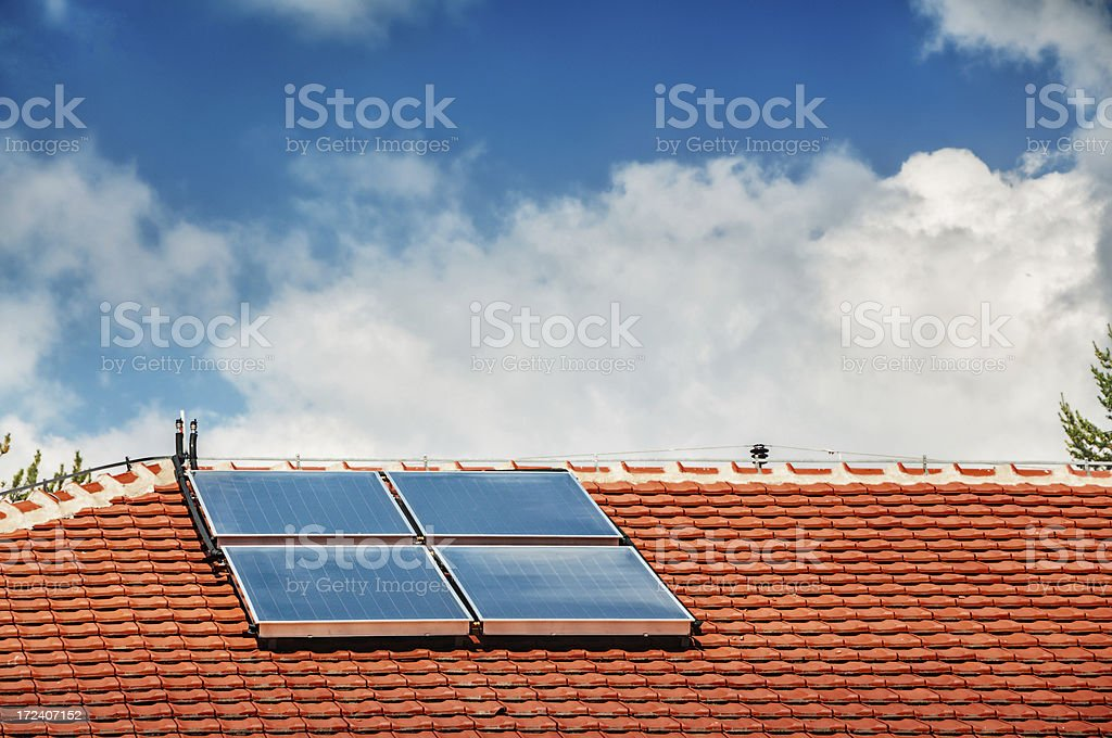 Solar Panels on the Roof for Energy Savings stock photo