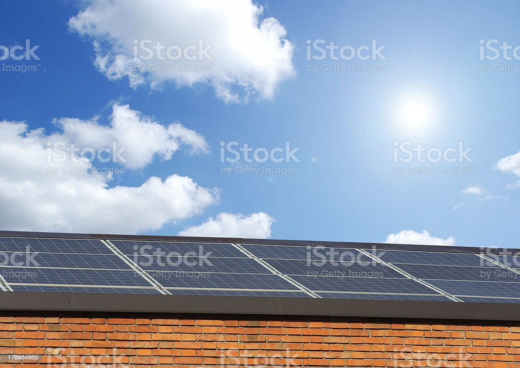 Solar panels on the roof of a building royalty-free stock photo