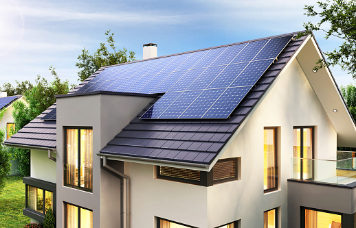 Solar panels on the gable roof of the beautiful house