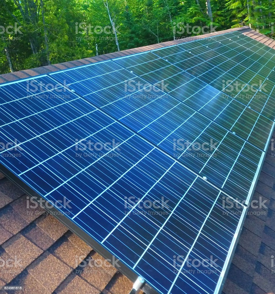 Solar panels on the roof to power the house stock photo
