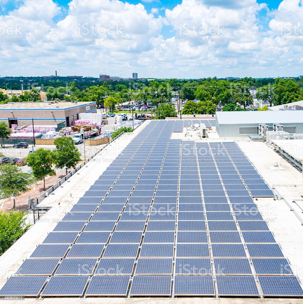 Solar Panels On Urban Rooftop stock photo