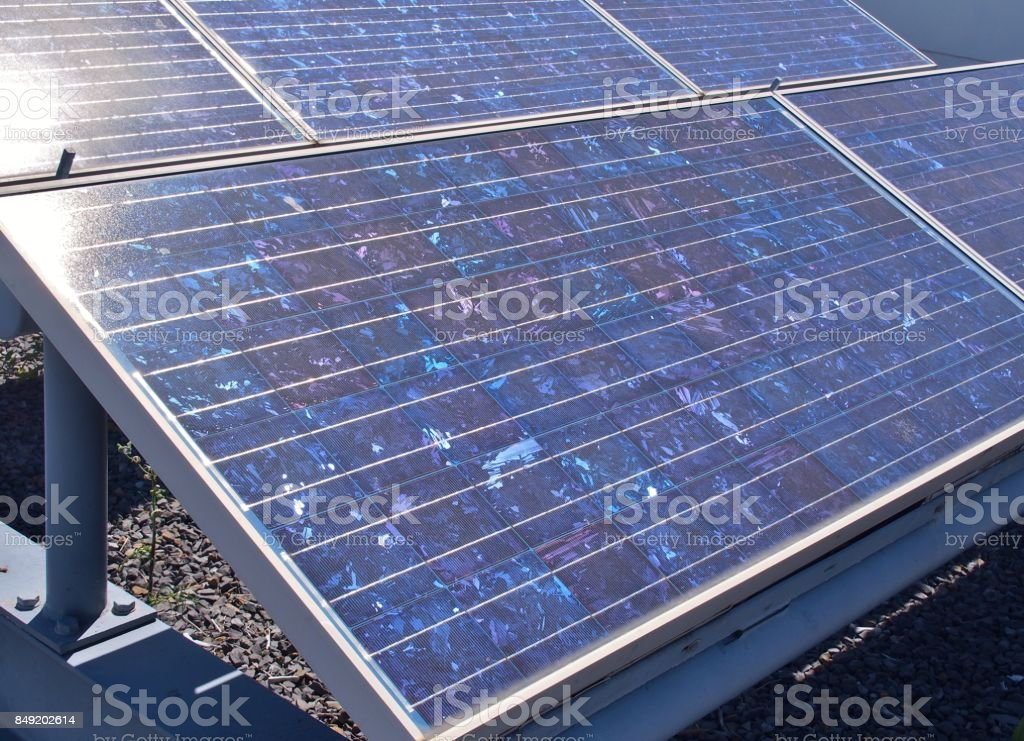 Solar panels or Polycrystalline Silicon Solar cells on rooftop stock photo